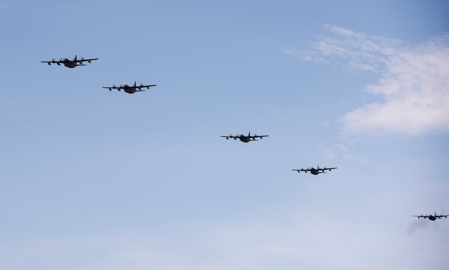 U.S. Air Force MC-130J Commando IIs from the 17th Special Operations Squadron return to base in a five-aircraft formation during a mass launch training mission June 22, 2017 at Kadena Air Base, Japan. Routine flights and airdrops are conducted to maintain proficiency and training certifications for prospective missions. (U.S. Air Force photo by Senior Airman Omari Bernard)