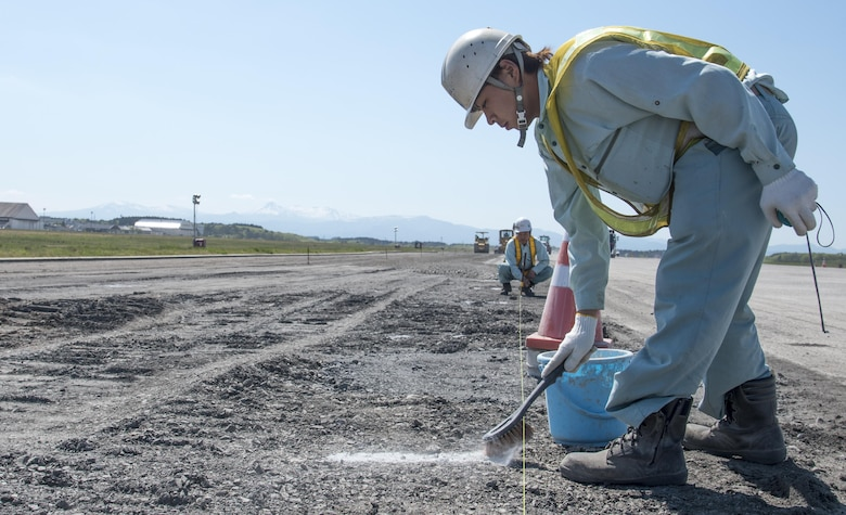 Japanese contractors conduct routine maintenance on the airfield at Misawa Air Base, Japan, May 18, 2017. The runway become fully operational June 26, more than a week ahead of schedule. The construction repaired degrading asphalt, spanning 1,463 meters, solidifying the 35th Fighter Wing to continue projecting power within the Indo-Asia-Pacific region and supporting its allies. (U.S. Air Force photo by Staff Sgt. Melanie Hutto)
