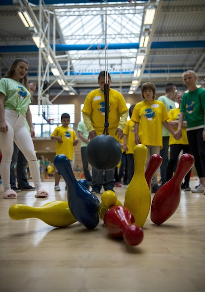 Marcel Dohring, student from Bitburg, knocks down bowling pins during the St. Martin Special Children's Day at Spangdahlem Air Base, Germany, June 28, 2017. Children from the event participated in a variety of activities including basketball throw, hula-hooping, balance beam and bowling. (U.S. Air Force photo by Senior Airman Preston Cherry)