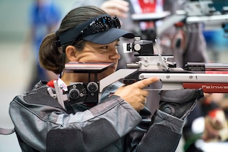Marine Corps Staff Sgt. Patricia Reynolds aims an air rifle during shooting practice for the 2017 Department of Defense Warrior Games in Chicago, June 29, 2017. DoD photo by EJ Hersom