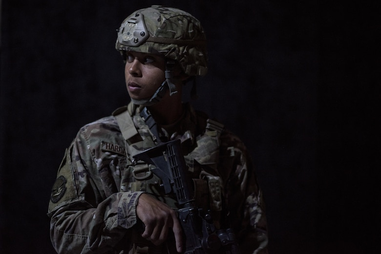 A member of the 332nd Expeditionary Security Forces Squadron looks over his shoulder while guarding an entrance point during an active-shooter exercise June 8, 2017, in Southwest Asia. The purpose of the exercise was to evaluate the squadron's ability to respond to an emergency and improve tactics in a simulated environment. (U.S. Air Force photo/Senior Airman Damon Kasberg)