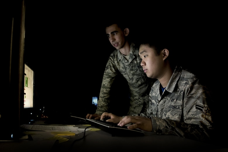 Senior Airman Joseph Goebel, left, and Airman 1st Class Anthony Ohara, both 35th Operations Support Squadron weather forecasters, analyze climate patterns during Red Flag-Alaska 17-2 at Eielson Air Force Base, Alaska, June 16, 2017. Goebel and Ohara were in charge of running the weather flight for RF-A, which consisted of seven other Air National Guardsman from Joint Base Lewis-McChord, Wash. (U.S. Air Force photo/Airman 1st Class Sadie Colbert)