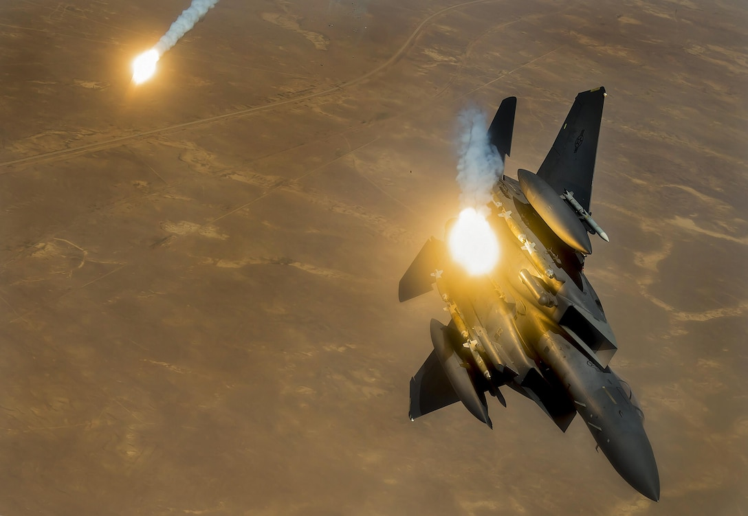 An F-15E Strike Eagle fires flares during a flight in support of Operation Inherent Resolve June 21, 2017. The F-15E, a component of U.S. Air Forces Central Command, supports U.S. and coalition forces working to liberate territory and people under the control of the Islamic State of Iraq and Syria. (U.S. Air Force photo/Staff Sgt. Trevor T. McBride)
