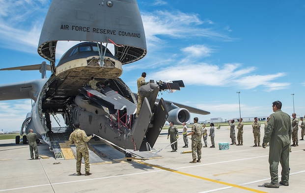 Soldiers from the 1st Calvary Division, 1st Air Combat Brigade, 615th Aviation Support Battalion from Ft. Hood, Texas and Airmen from the 26th and 74th Aerial Port Squadrons begin loading a UH-60 Black Hawk helicopter into the cargo hold of a C-5M Super Galaxy June 22, 2017 at Joint Base San Antonio-Lackland, Texas. Operation Silver Galaxy was a five-day training event that featured Airmen training Soldiers on how to secure their aircraft for a deployment in the cargo area of a C-5M Super Galaxy. (U.S. Air Force photo by Benjamin Faske)