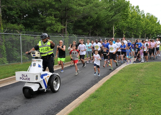 Employees and family members join in the annual Family Day Fun Run June 27, 2017.