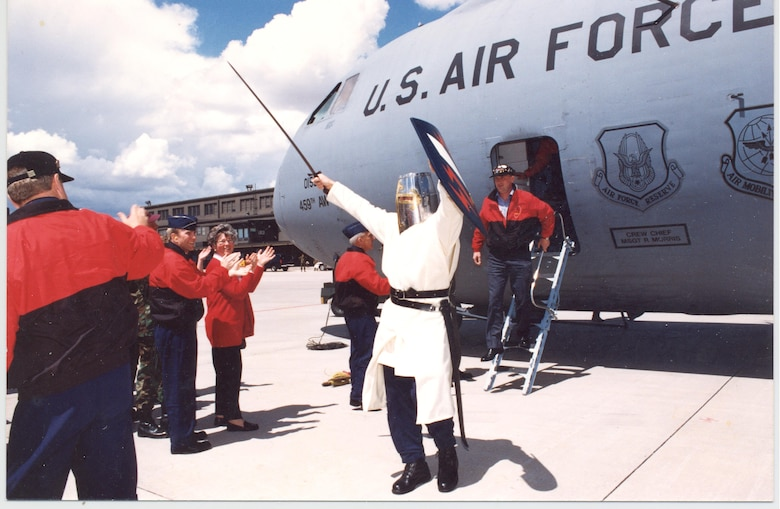 PETERSON AIR FORCE BASE, Colo. - Iron Mike returns victorious from a Guardian Challenge in 1998 as senior wing personnel greet the team's arrival.  The second costume was an upgrade, compliments of Laird Jeffrey Burn, Old Buittle Castle, Scotland, who worked with Dr. David Bullock, 21st Space Wing History Office chief, on the project. (Courtesy photo)