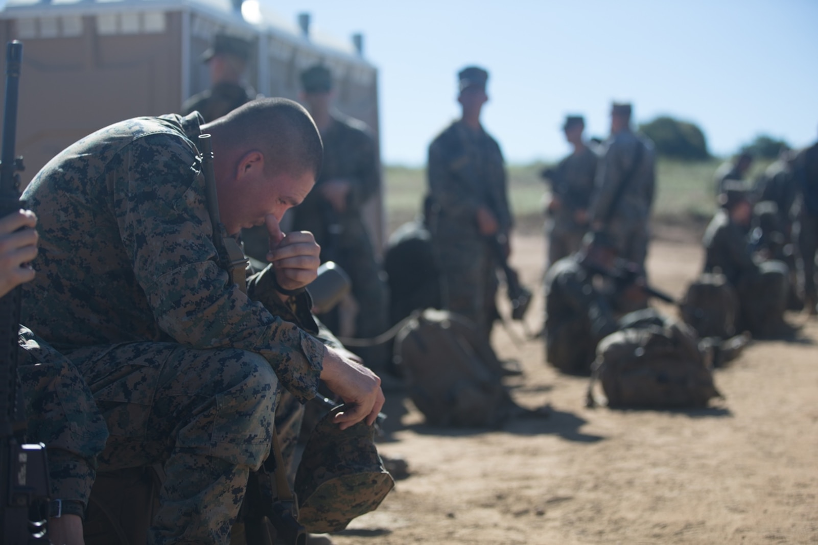 U.S. Marine Lance Cpl. Scott Patterson, an electronic maintainer with Combat Logistics Battalion 5, Headquarters Regiment, 1st Marine Logistics Group, pauses during a seven mile conditioning hike on Camp Pendleton, Calif., June 27, 2017. The Marines have multiple conditioning hikes to prepare for Mountain Exercise 4-17 which will be conducted at the Marine Corps Mountain Warfare Training Center in Bridgeport, Calif. (U.S. Marine Corps photo by Lance Cpl. Timothy Shoemaker)