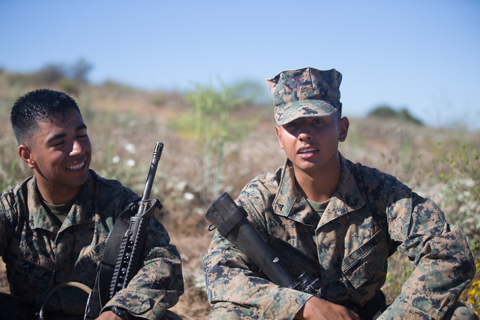 U.S. Marine Lance Cpls. Luis Orozohernandez and Lance Cpl. Luis Mejia, motor transportation operators for Combat Logistics Battalion 5, Headquarters Regiment, 1st Marine Logistics Group take a break during a seven mile conditioning hike on Camp Pendleton, Calif., June 27, 2017. The Marines have multiple conditioning hikes to prepare for Mountain Exercise 4-17 which will be conducted at the Marine Corps Mountain Warfare Training Center in Bridgeport, Calif. (U.S. Marine Corps photo by Lance Cpl. Timothy Shoemaker)