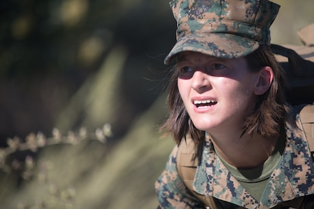 U.S. Marine Pfc. Catherine Mason, an electrician with Combat Logistics Battalion 5, Headquarters Regiment, 1st Marine Logistics Group, participates in a conditioning hike on Camp Pendleton, Calif., June 27, 2017. The Marines have multiple conditioning hikes to prepare for Mountain Exercise 4-17 which will be conducted at the Marine Corps Mountain Warfare Training Center in Bridgeport, Calif. (U.S. Marine Corps photo by Lance Cpl. Timothy Shoemaker)