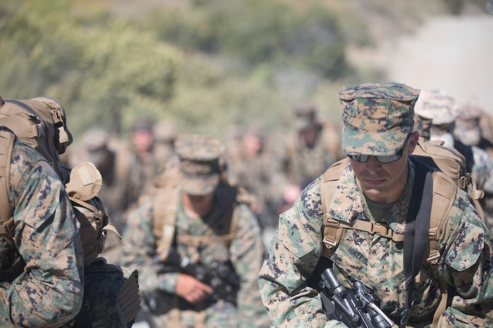 U.S. Marines and Sailors with Combat Logistics Battalion 5, Combat Logistics Regiment 1, 1st Marine Logistics Group participate in a conditioning hike on Camp Pendleton, Calif., June 27, 2017. The Marines have multiple conditioning hikes to prepare for Mountain Exercise 4-17 which will be conducted at the Marine Corps Mountain Warfare Training Center in Bridgeport, Calif. (U.S. Marine Corps photo by Lance Cpl. Timothy Shoemaker)