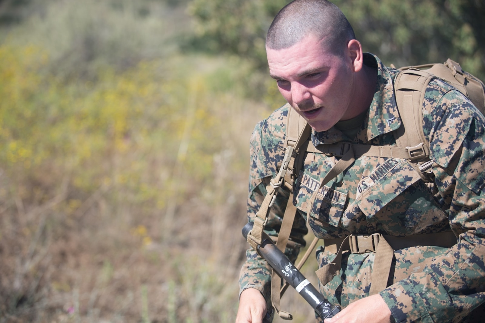 U.S. Marine Lance Cpl. Scott Patterson, an electronics maintainer with Combat Logistics Battalion 5, Headquarters Regiment, 1st Marine Logistics Group participates in a conditioning hike on Camp Pendleton, Calif., June 27, 2017. The Marines have multiple conditioning hikes to prepare for Mountain Exercise 4-17 which will be conducted at the Marine Corps Mountain Warfare Training Center in Bridgeport, Calif. (U.S. Marine Corps photo by Lance Cpl. Timothy Shoemaker)