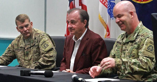 (From left) Lt. Gen. Jeffrey S. Buchanan, commander of U.S. Army North (Fifth Army) at Joint Base San Antonio-Fort Sam Houston; John Sharp, chancellor of Texas A&M University System; and Brig. Gen. John Hashem, deputy commanding general-support and director of Army North's Army Reserve Engagement Cell, or AREC, prepare to sign the Memorandum of Understanding at Laredo Community College's De La Garza building in Laredo, Texas, June 27 during the Innovative Readiness Training (IRT) Mission. This memorandum signifies the commitment of the military and the surrounding communities in future IRT missions.