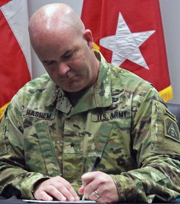 Brig. Gen. John Hashem, deputy commanding general-support and director of Army Reserve Engagement Cell, or AREC, at U.S. Army North (Fifth Army), signs the Memorandum of Understanding at Laredo Community College's De La Garza building in Laredo, Texas, June 27 during the Innovative Readiness Training, or IRT, Mission. This memorandum signifies the commitment of the military and the surrounding communities for future IRT missions.