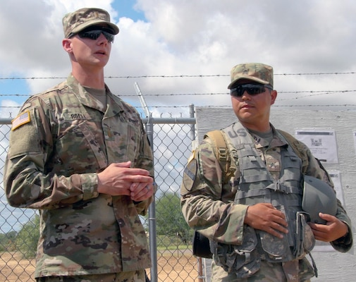 Second Lt. Michael Roell (left) and Sgt. Reuben Aleman, engineers with U.S. Army Reserve 312th Engineer Company, explain their project board during a briefing to distinguished visitors for the Innovative Readiness Training, or IRT, mission June 27 in Laredo, Texas. Both engineers were tasked with road improvement during the IRT mission as part of their two-week training.