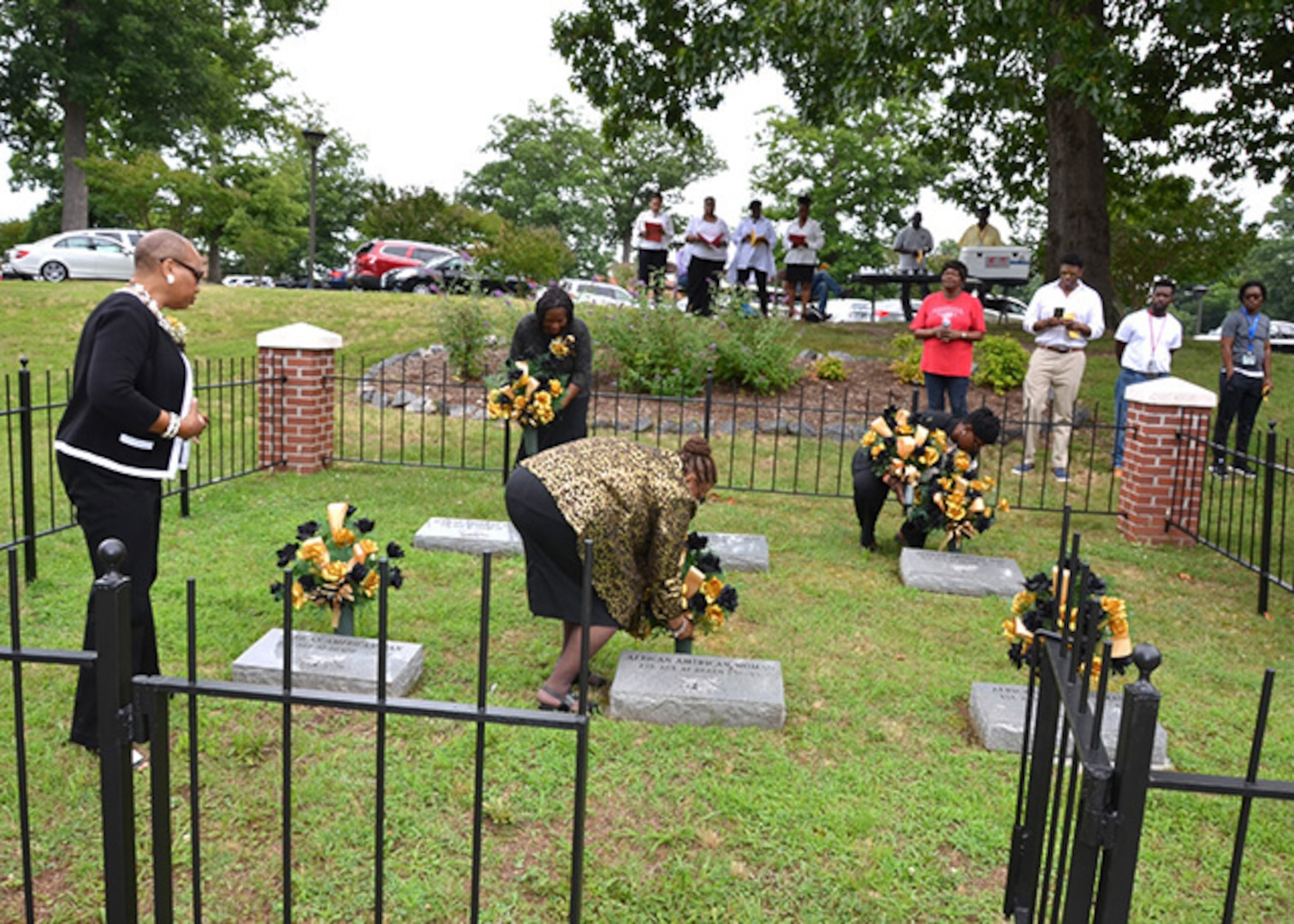 Defense Logistics Agency Aviation's Bellwood Chapter of Blacks in Government members place flowers on the graves of unknown African-Americans during the Juneteenth Observance celebrated June 23, 2017 on Defense Supply Center Richmond, Virginia.