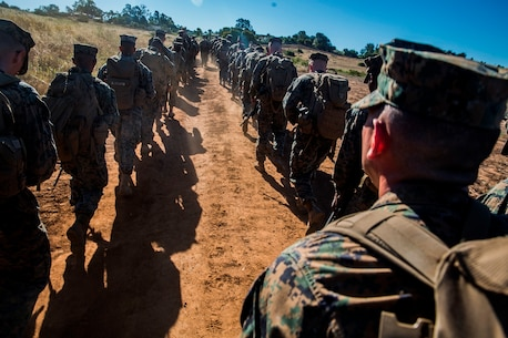 U.S. Marines and Sailors with Combat Logistics Battalion 5, Combat Logistics Regiment 1, 1st Marine Logistics Group participate in a seven mile conditioning hike on Camp Pendleton, Calif., June 27, 2017. The Marines have multiple conditioning hikes to prepare for Mountain Exercise 4-17 which will be conducted at the Marine Corps Mountain Warfare Training Center in Bridgeport, Calif. (U.S. Marine Corps photo by Lance Cpl. Adam Dublinske)
