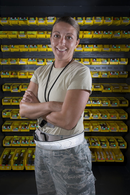 Airman 1st Class Stacey Deluca, 436th Maintenance Squadron Regional ISO Dock consolidated tool krib custodian, stands in front of a bench stock part cabinet June 28, 2017, on Dover Air Force Base, Del. Deluca joined the Air Force at age 39 after watching her son graduate Air Force Basic Military Training. (U.S. Air Force photo by Senior Airman Aaron J. Jenne)