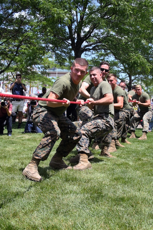 Marines compete in tug-of-war during Sail Boston 2017 at Marine Park in Boston, Mass., June 21, 2017. The event was one of many during Sail Boston that brought together Marines, Sailors and the community to foster high spirits and a team mentality. Some of the many physical events that took place during Sail Boston included tug-of-war, a soccer tournament, and a patriot run. (U.S. Marine Corps photo by Cpl. Mackenzie Gibson/Released)