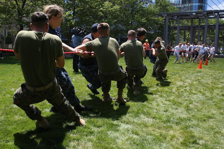 Boston 2017 at Marine Park in Boston, Mass., June 21, 2017. The event was one of many during Sail Boston that brought together Marines, Sailors and the community to foster high spirits and a team mentality. Some of the many physical events that took place during Sail Boston included tug-of-war, a soccer tournament, and a patriot run. (U.S. Marine Corps photo by Cpl. Mackenzie Gibson/Released)