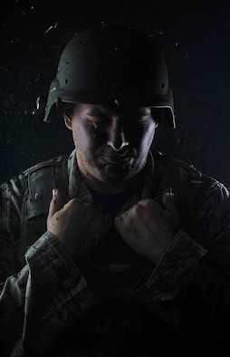Retired U.S. Air Force Staff Sgt. Clifton Flint, formerly 48th Security Forces Squadron base defense operations center controller, poses for a photo to represent post-traumatic stress disorder June 30, 2017, on RAF Mildenhall, England. June is National PTSD Awareness Month. Flint suffers from post-traumatic stress disorder, brought on after sustaining a traumatic brain injury while deployed to Iraq in 2005. (U.S. Air Force photo by Staff Sgt. Micaiah Anthony)