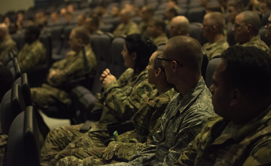 Enlisted members of the 353rd Special Operations Group listen to Air Force Special Operations Command Chief Master Sgt. Gregory Smith during an all-call June 19, 2017 at Kadena Air Base, Okinawa, Japan. Smith described the significance of these changes, provided resources and emphasized the choices Airmen need to make. (U.S. Air Force photo by Capt. Jessica Tait)
