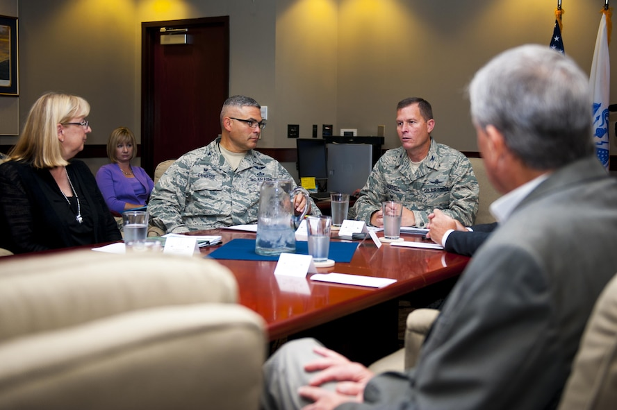 Barbara Koscak, STARBASE, Col. Alejandro Ganster, 17th Training Group Commander, and Col. Jeffery Sorrell, 17th Training Wing Vice Commander, talk during a meeting on STARBASE in the Wing Conference Room in the Norma Brown building on Goodfellow Air Force Base, Texas, June 17, 2017. The  STARBASE academies serve students that are historically under-represented in STEM.  Students who live in inner cities or rural locations, those who are socio-economically disadvantaged, low in academic performance or have a disability are in the target group. The program encourages students to set goals and achieve them. (U.S. Air Force photo by Senior Airman Scott Jackson/Released)
