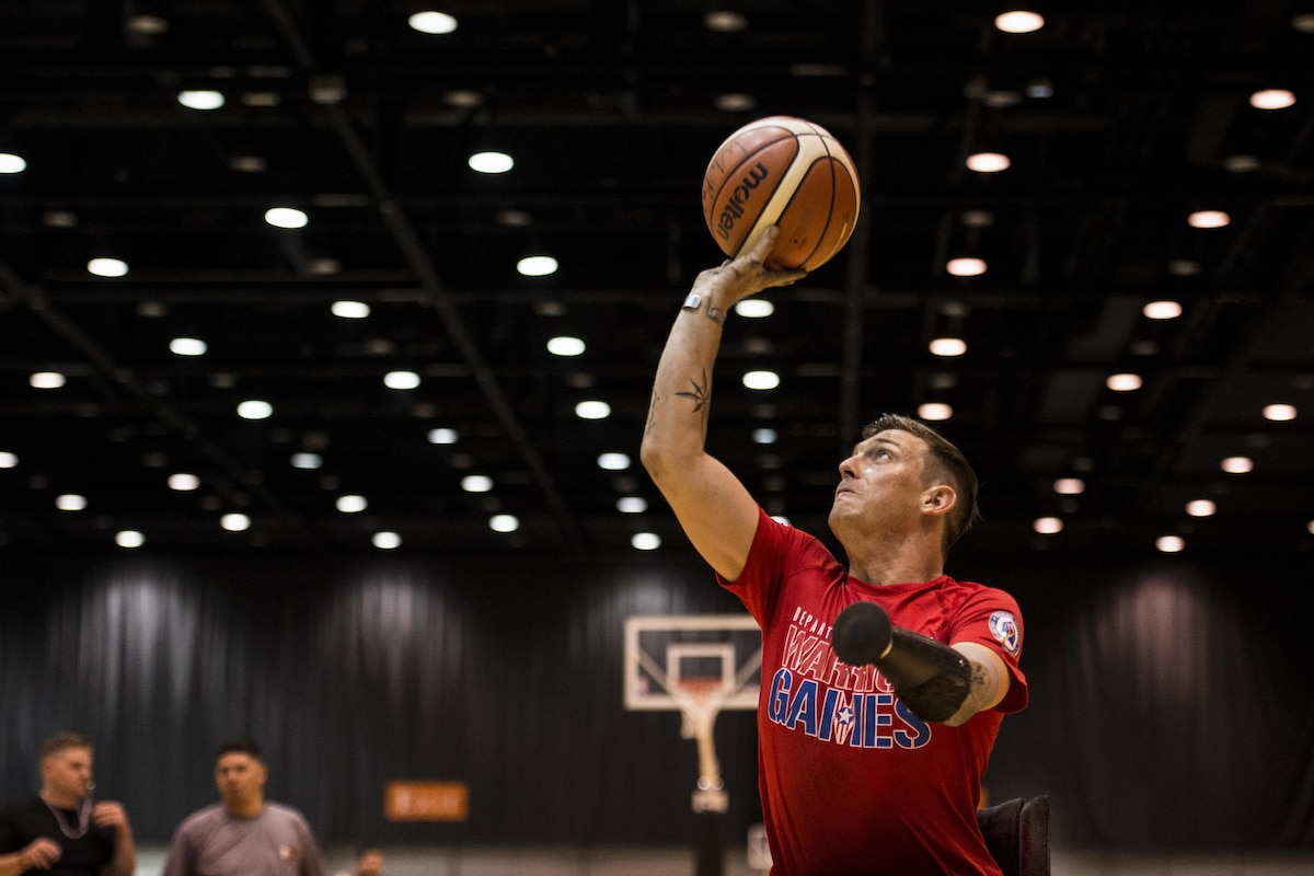 A Marine takes a shot during wheelchair basketball practice.