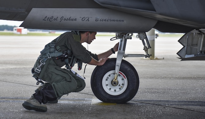 U.S. Air Force Capt. Michael Sayers, 95th Fighter Squadron F-22 Raptor pilot, inspects the front of an F-22 before takeoff at Tyndall Air Force Base, Fla., June 26, 2017. Upon landing, Sayers' sortie was recorded as the 10,000 F-22 sortie since the squadron's reactivation in October 2013. (U.S. Air Force photo by Senior Airman Dustin Mullen/Released)