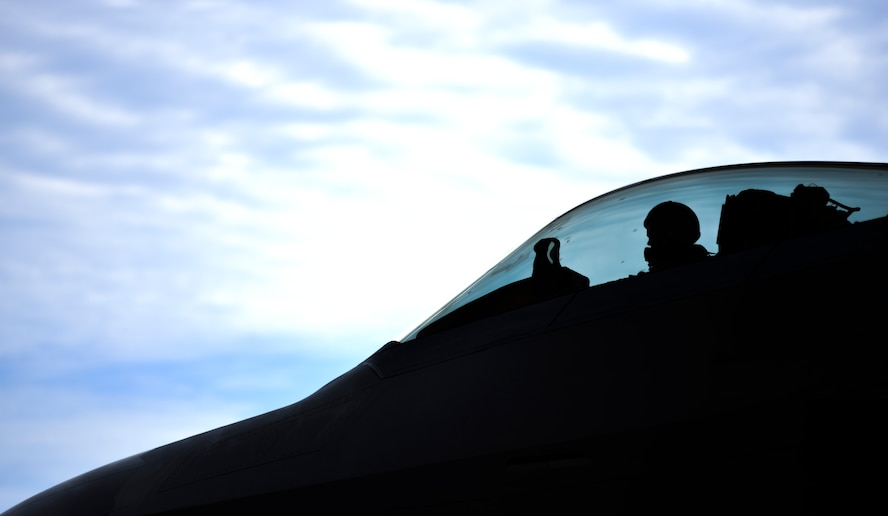 "U.S. Air Force Capt. Michael Sayers, 95th Fighter Squadron F-22 Raptor pilot, prepares to taxi an F-22 onto the flightline at Tyndall Air Force Base, Fla., June 26, 2017. The 95th FS ""Boneheads"" reached their 10,000 sortie milestone once Sayers landed the jet. (U.S. Air Force photo by Senior Airman Dustin Mullen/Released)"