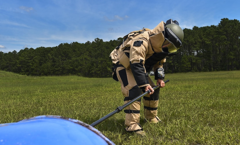 Staff Sgt. Eric Jones, 628th Civil Engineer Squadron explosive ordnance disposal technician, reaches for an ordinance during training exercise Mogul Wrath, June 27, 2017. EOD trains consistently to sharpen their skills and readiness.