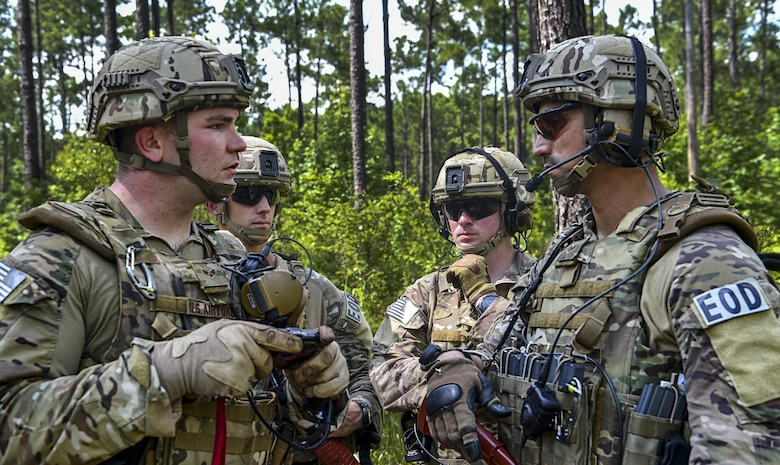 Airmen from the 628th Civil Engineer Squadron explosive ordnance disposal shop discuss a plan of action during operation Mogul Wrath, June 27, 2017. Mogul Wrath is an extensive training operation EOD here hopes to implement semi-annually.