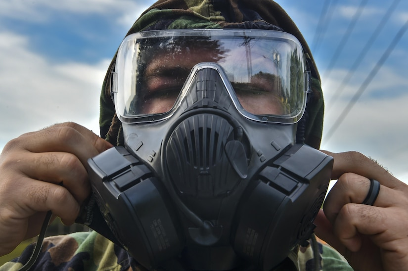 Senior Airman Dylan Babb, 628th Civil Engineer Squadron explosive ordnance disposal technician, dons a gas mask during training, June 28, 2017. EOD here trained over the course of a week to ensure they are retaining knowledge and can efficiently use their skillsets in real world situations.