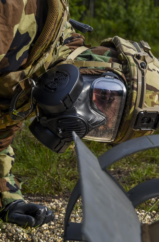 Senior Airman Dylan Babb, 628th Civil Engineer Squadron explosive ordnance disposal technician, performs reconnaissance on unexploded ordnance, June 28, 2017. During training operation Mogul Wrath teams completed training events using various practical skills, EOD specialized equipment and scenario-based, full spectrum emergency responses.