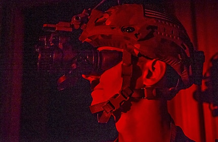 Senior Airman Michael Frook, 628th Civil Engineer Squadron explosive ordnance disposal technician, uses his night vision goggles during training exercise Mogul Wrath, June 29, 2017. The training operation incorporated nighttime operations, wartime expedient chemical munition procedures and tactical vehicle operations.