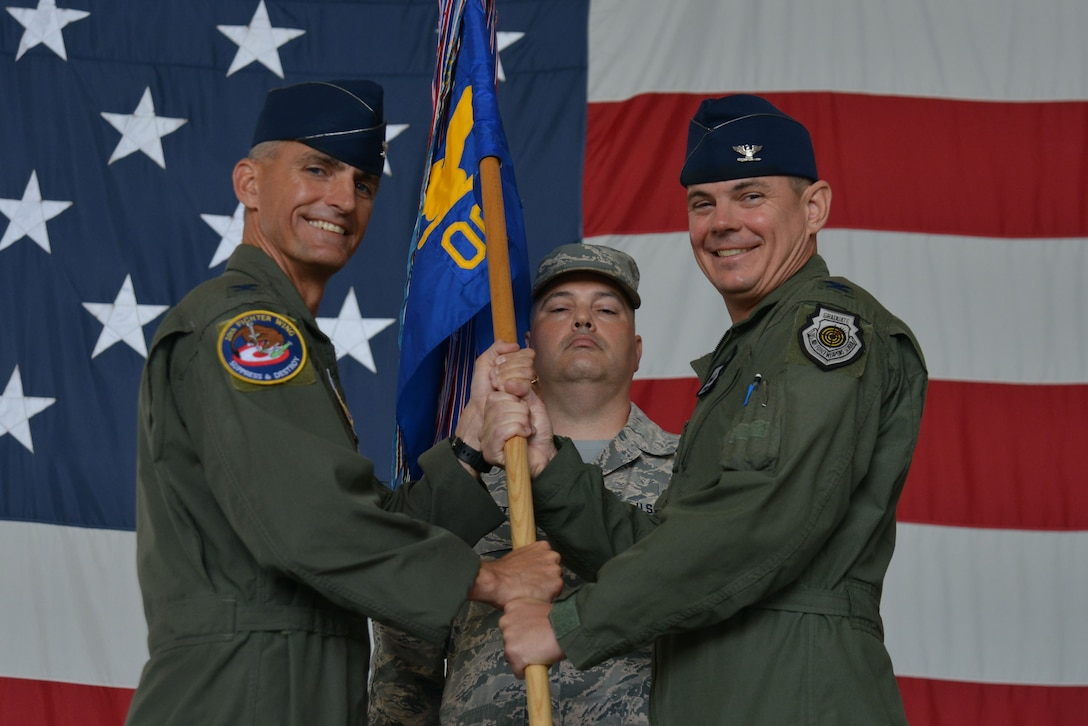 U.S. Air Force Col. Brian Jackson, 20th Operations Group (OG) commander, receives the 20th OG guidon from Col. Daniel Lasica, 20th Fighter Wing commander, during a change of command ceremony at Shaw Air Force Base, S.C., June 30, 2017. The 20th OG employs 79 F-16CM Fighting Falcons to perform various missions including the suppression of enemy air defenses, close air support and combat search-and-rescue missions. (U.S. Air Force photo by Airman 1st Class Destinee Sweeney)