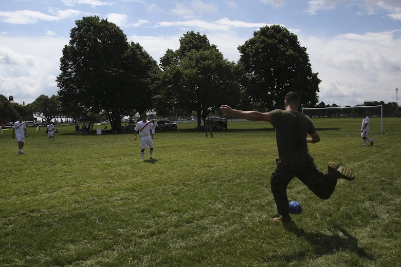Lance Cpl. Scott Harder winds up to kick the ball to his teammates during the Sail Boston 2017 Soccer Tournament held at Joe Moakley Park in Boston, Mass., June 20, 2017. The tournament was a friendly competition aimed at establishing rapport among service members from around the world and others participating in Sail Boston. Marines and Sailors from countries including Chile, Peru, and Ecuador attended the tournament. Harder is a motor transport specialist assigned to Combat Logistics Battalion 8, Combat Logistics Regiment 2, 2nd Marine Logistics Battalion. (U.S. Marine Corps photo by Cpl. Mackenzie Gibson/Released)