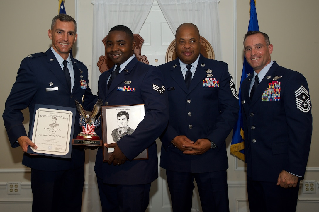 U.S. Air Force Senior Airman Fernando Elliott, 31st Intelligence Squadron, receives the John L. Levitow Award from Col. Daniel Lasica, 20th Fighter Wing commander, for class 17-5 of the Senior Master Sgt. David B. Reid Airman Leadership School at Shaw Air Force Base, S.C., June 30, 2017. The Levitow Award is given to the graduate with the highest average of instructor and student points, and is the highest award in enlisted professional military education. (U.S. Air Force photo by Senior Airman Michael Cossaboom)