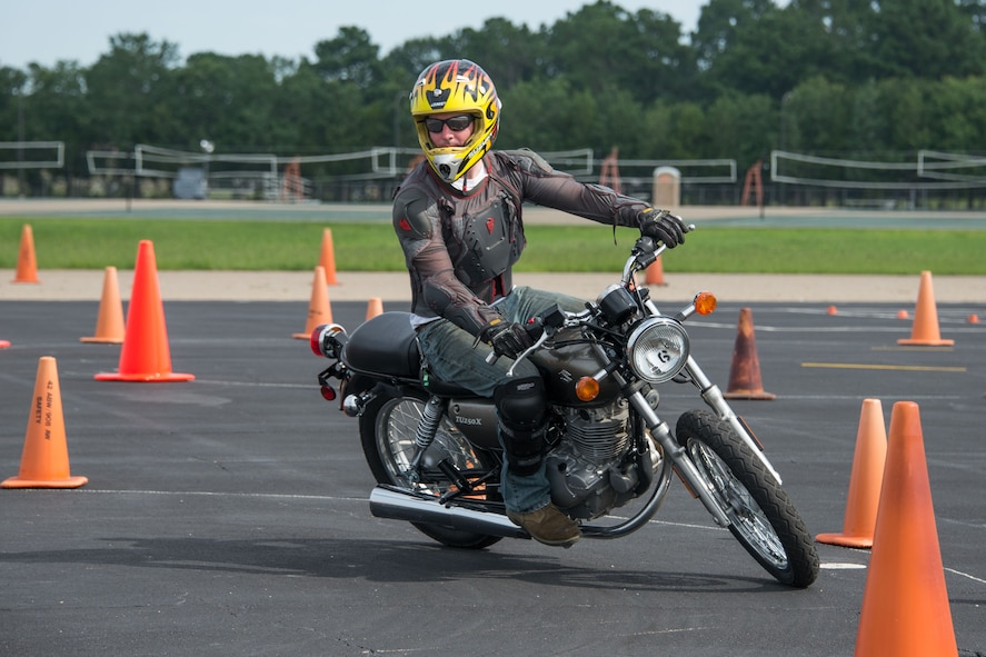 Staff Sgt. Jody Perkins, Air Force Life Cycle Management Center, rounds a turn during a timed motorcycle course, during the Motorcycle Safety Day, June 27, 2017. The timed course was one of four courses motorcyclists could participate in during the safety day. (US Air Force photo/Trey Ward/Released)