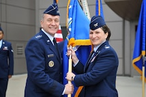 Lt. Gen. David J. Buck, commander, 14th Air Force (Air Forces Strategic) and Joint Functional Component Command for Space, welcomes Col. Jennifer Grant to her new post as 50th Space Wing commander during the wing's change of command ceremony Friday, June 30, 2017 at Schriever Air Force Base, Colorado. Grant returns to command at Schriever as she previously commanded the 2nd Space Operations Squadron. (U.S. Air Force photo/Dennis Rogers)