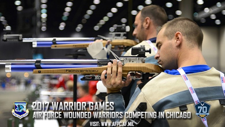 U.S. Air Force 2nd Lt. Ryan Novack [front], a munitions and missile maintenance officer from Aurora, Ill., and U.S. Air Force Reserve Tech. Sgt. Jett Blackwell [rear], a fuels technician from Bethany, Okla., take part in a practice shoot session in preparation for the 2017 Warrior Games June 29, 2017 at McCormick Place-Lakeside Center, Chicago, Ill. The Warrior Games were established in 2010 to enhance the recovery and rehabilitation process of wounded warriors, while exposing them to adaptive sports. (U.S. Air Force photo by Staff Sgt. Alexx Pons)