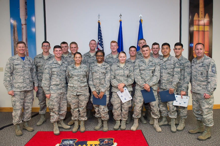 Fifteen Airmen who completed the first Airmanship 300 course pose for a photo June 30, 2017, at the First Term Airmen Center, Patrick Air Force Base, Fla.  The new course is a continuation of the training the Air Force military personnel received at Basic Military Training (Airman 100) and technical training (Airman 200), building upon the skills they've already been introduced to.  The First Term Airmen Center recently transitioned to the Air Force's new professional development curriculum with a focus on developing Airmen as next-generation leaders. (U.S. Air Force photo by Matthew Jurgens)