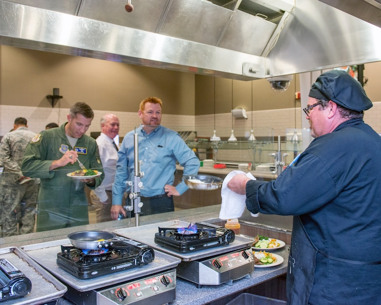 Maynard Oestreich, executive chef for Aramark prepares meals during the BIBIM Box tasting featuring Korean food at Sierra Inn Dining Facility, Travis Air Force Base, Calif., June 29, 2017. Oestreich a former U.S. Navy veteran and an award-winning chef from Napa Valley, Calif., took the head chef position so he could mentor young Airmen. (U.S. Air Force photo by Louis Briscese)