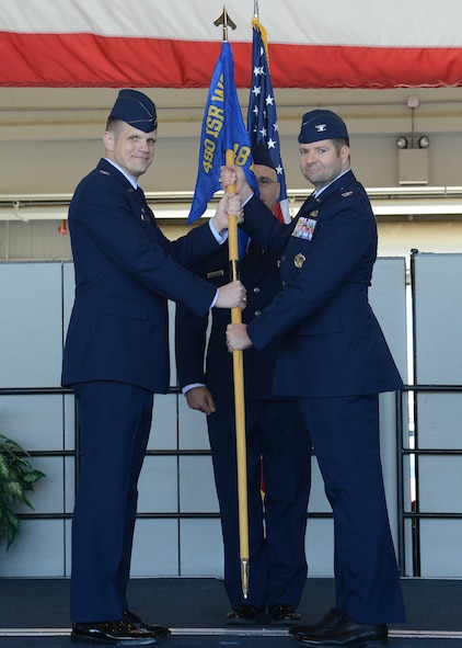 Col. Jason M. Brown, 480th Intelligence, Surveillance and Reconnaissance Wing commander, passes the guidon to Col. Scott J. Nahrgang, 548th ISR Group commander, at Beale Air Force Base, Calif., June 26, 2017. The 548th ISRG's subordinate units include the 9th, 13th, and 48th Intelligence Squadrons and the 548th Operations Support Squadron. (U.S. Air Force photo by Airman 1st Class Andrew Moore/Released)
