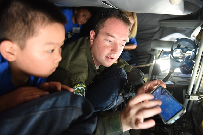 Staff Sgt. Noah Starnes, 77th Air Refueling Squadron boom operator, explains the mission of the KC-135 Stratotanker to Science and Technology Academies Reinforcing Basic Aviation and Space Exploration program students, June 19, 2017, at Seymour Johnson Air Force Base, North Carolina. STARBASE is a weeklong program that allows rising fifth-grade students to tour Seymour Johnson AFB and learn about several military career fields and the science behind them. (U.S. Air Force photo by Senior Airman Ashley Maldonado)