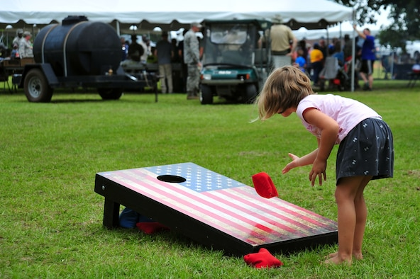 A Team Shaw child plays cornhole during the Freedom Bash at Shaw Air Force Base, S.C., June 30, 2017. The 20th Force Support Squadron hosted the annual event in celebration of Independence Day. (U.S. Air Force photo by Airman 1st Class Kathryn R.C. Reaves)