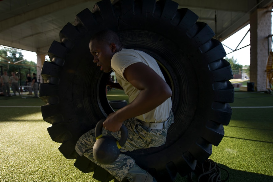 A Junior ROTC cadet climbs through a tire at the end of an obstacle course at the Special Tactics Training Squadron, Hurlburt Field, Fla., June 26, 2017. The JROTC Summer Leadership School program brought more than 50 cadets to Hurlburt Field to engage in a variety of team-building and leadership skill-developing exercise under the guidance of Air Commandos, June 26 – 30. (U.S. Air Force photo by Staff Sgt. Victor J. Caputo)