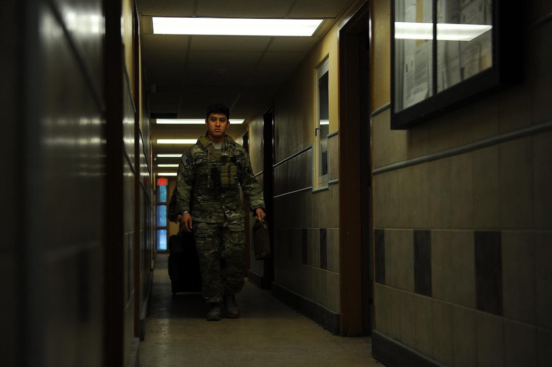 Staff Sgt. Paoloarnold Pineda, an explosive ordnance disposal craftsman with the 1st Special Operations Civil Engineering Squadron, walks toward the room where a hostage is being held during an exercise at Hurlburt Field, Fla., June 21, 2017. EOD technicians are trained to detect, disarm, detonate and dispose of explosive threats as safely as possible. (U.S. Air Force photo by Airman 1st Class Isaac O. Guest IV)