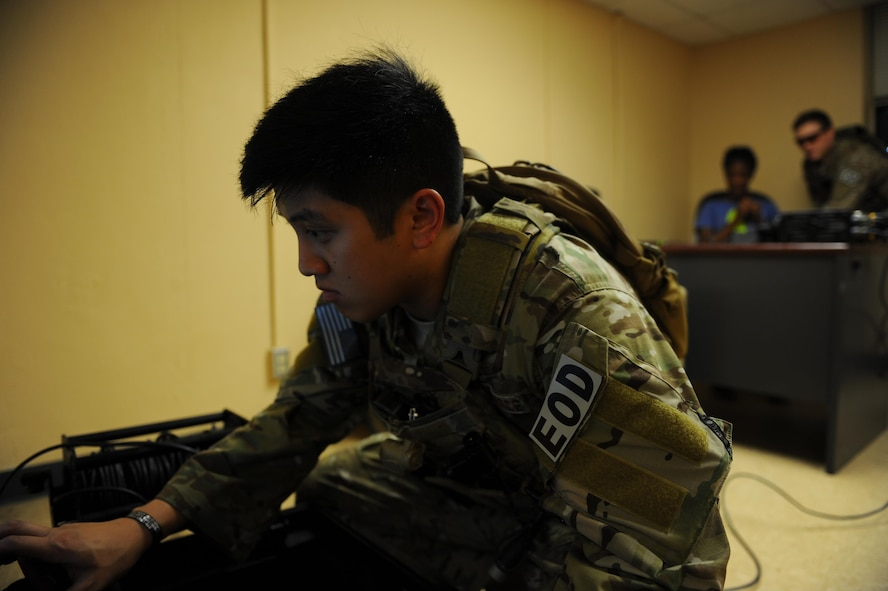 Staff Sgt. Paoloarnold Pineda, an explosive ordnance disposal craftsman with the 1st Special Operations Civil Engineering Squadron, operates an X-Ray machine to investigate what type of bomb is attached to the hostage during an exercise at Hurlburt Field, Fla., June 21, 2017. The exercise placed EOD technicians through a real-world scenario to test their abilities in disarming bombs and maintain global readiness. (U.S. Air Force photo by Airman 1st Class Isaac O. Guest IV)