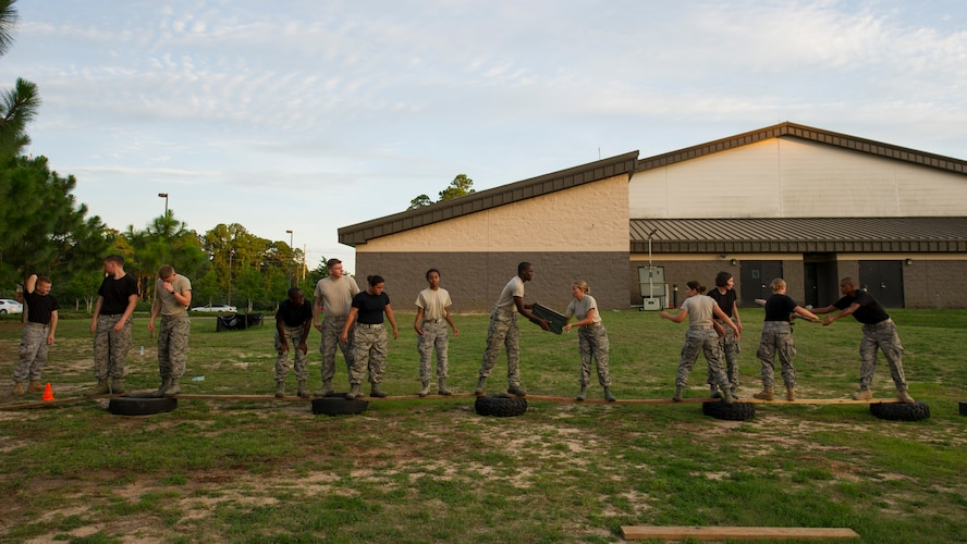 Junior ROTC cadets pass equipment across a makeshift bridge of tires and planks during a team-building exercise at Hurlburt Field, Fla., June 26, 2017. The JROTC Summer Leadership School program brought more than 50 cadets to Hurlburt Field to engage in a variety of team-building and leadership skill-developing exercises under the guidance of Air Commandos, June 26 – 30. (U.S. Air Force photo by Staff Sgt. Victor J. Caputo)