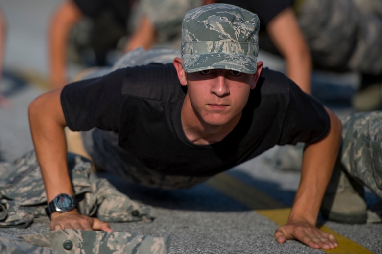 A Junior ROTC cadet performs push-ups with his wingmen during a JROTC Summer Leadership School trip to Hurlburt Field, Fla., June 26, 2017. More than 50 cadets visited the base to engage in a variety of team-building and leadership skill-developing exercises under the guidance of Air Commandos from across Hurlburt Field. (U.S. Air Force photo by Staff Sgt. Victor J. Caputo)